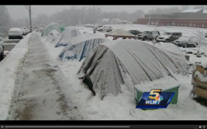 Parents camp in tents during an early October snowstorm to enroll their children in Dater Montessori School, Cincinnati, Ohio. Photo credit: WLWT Channel 5, Cincinnati